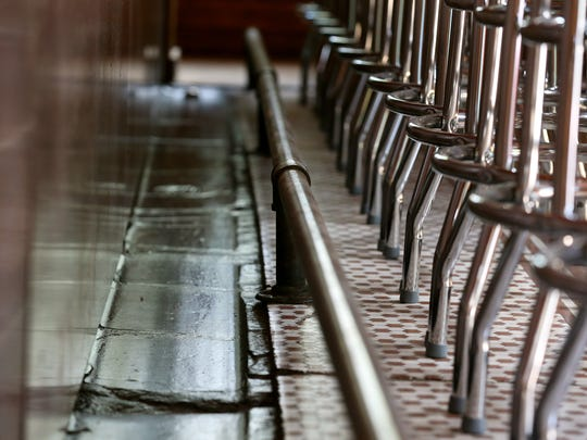 A trough and foot rail runs along the bar at Dicky's Corner Pub on Meigs Street.