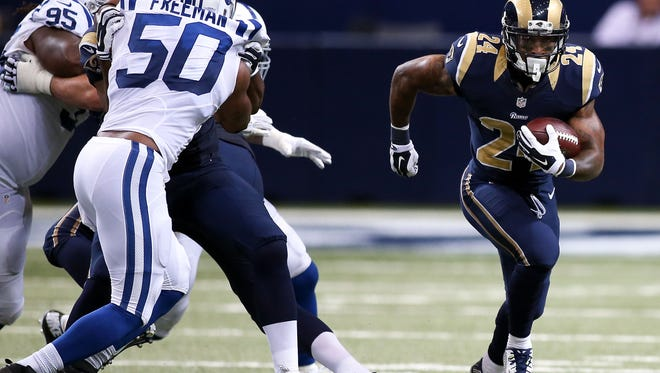 St. Louis Rams running back Isaiah Pead (24) carries the ball during the second quarter of a football game against the Indianapolis Colts in August of 2015.