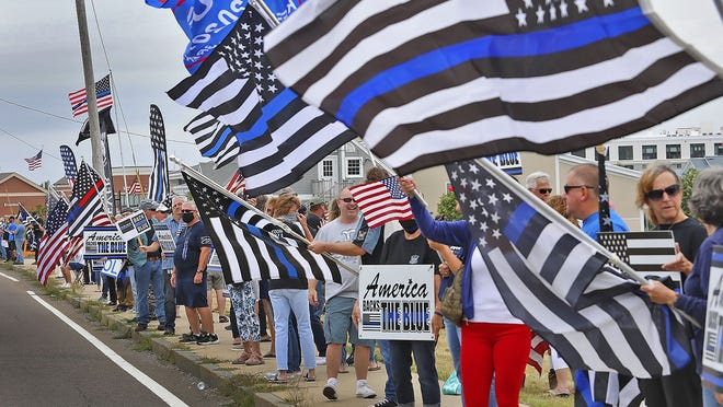 A group gathered in Hingham to show support of police officers on  Aug. 16.