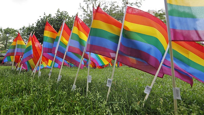 Quincy Pride flag installation at the United First Parish Church in Quincy Square on Thursday June 11, 2020 Greg Derr/The Patriot Ledger