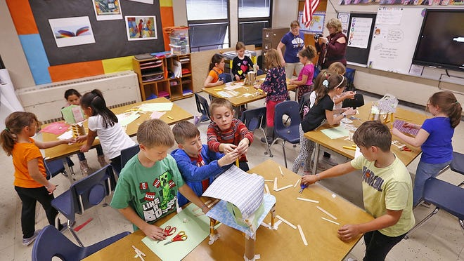 Nash School second graders engineer small scale tree house models in STEM class at the Nash School last fall.