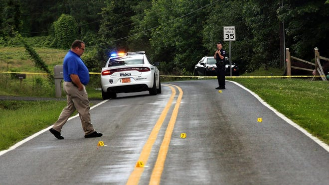 Investigators work a crime sceen of one of Cleveland County's homicides.