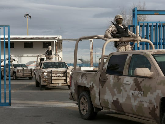 "Mexican soldiers leave an airport in Juárez after the extradition of drug lord Joaquin ""Chapo"" Guzmán on Thursday."