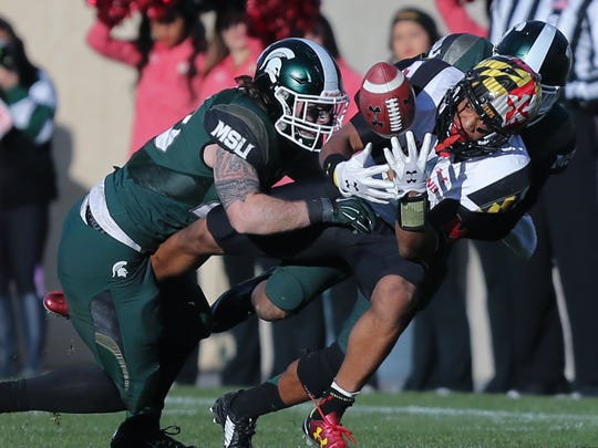 Chris Frey defends against Maryland's D.J. Moore during the second half of MSU's win in East Lansing.