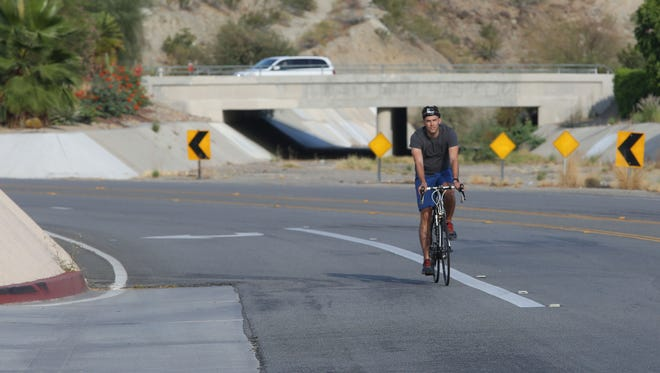 A cyclist rides on the path of the CV Link on Parkview Dr. in Palm Desert.