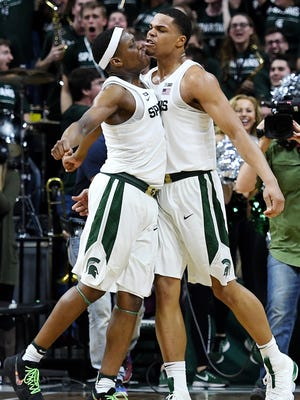 Michigan State's Miles Bridges, right, celebrates after his go ahead 3-pointer with Cassius Winston during the second half on Saturday, Feb. 10, 2018, at the Breslin Center in East Lansing. The Spartans beat Purdue 68-65.