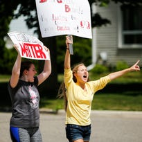 Grand Ledge High School students march after school June 2 in support of the district's teachers. The district's teachers have been working under an expired contract for the past 10 months.
