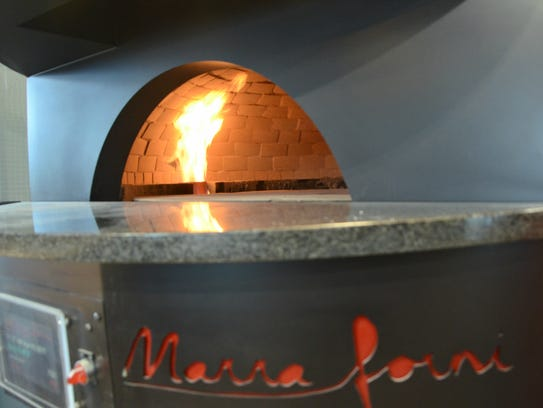 A view of the pizza oven inside The Fire Hub, 175 S.