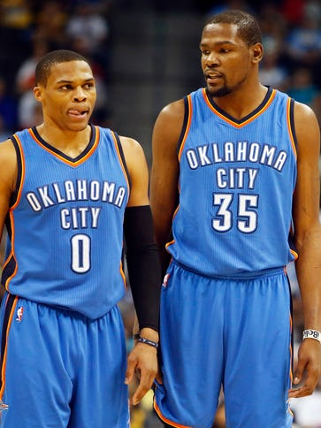 Russell Westbrook and Kevin Durant on the court against