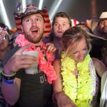 Festival-goers dance to DJ KO inside the Electric Thunder tent at Country Thunder music festival on Saturday, Apr. 9, 2016 in Florence, Ariz.