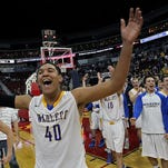 Dubuque Wahlert's Cordell Pemsl, center, lead his teammates to their fans as they celebrated win over Central (DeWitt) in a Class 3A championship final at the 2014 state basketball tournament.