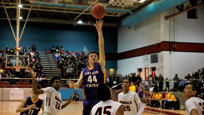 Kirtland Central's Bryson Dowdy knocks down a shot against Gallup during the first quarter of Monday's District 1-5A championship tiebreaker game at Shiprock High. The Broncos won, 52-46.