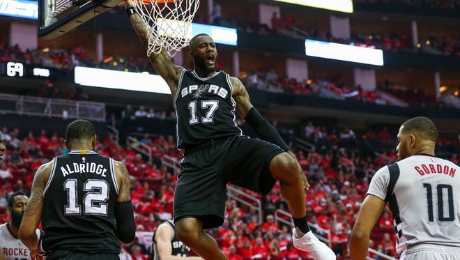 May 11, 2017; Houston, TX, USA; San Antonio Spurs guard Jonathon Simmons (17) dunks the ball during the third quarter against the Houston Rockets in game six of the second round of the 2017 NBA Playoffs at Toyota Center. Mandatory Credit: Troy Taormina-USA TODAY Sports