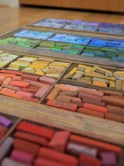Arlene Braithwaite uses this portable collection of pastels when she travels to create art on location.