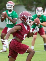 NMSU wide receiver OJ Clark runs a route as quarterbacks