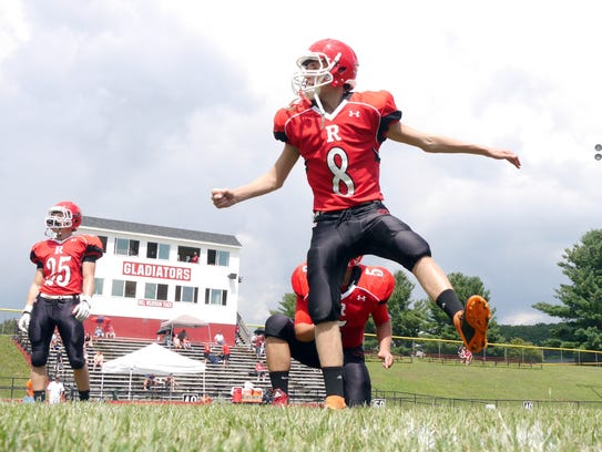 Riverheads kicker, #8 Rinaldo Martina hits some warm-up