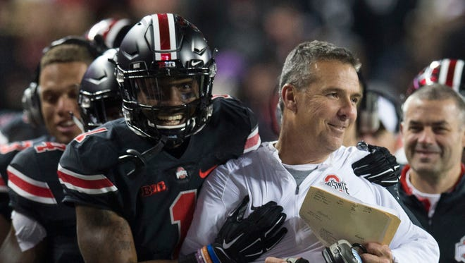 Ohio State Buckeyes wide receiver Braxton Miller (1) celebrates with head coach Urban Meyer after he scored against the Penn State Nittany Lions at Ohio Stadium.