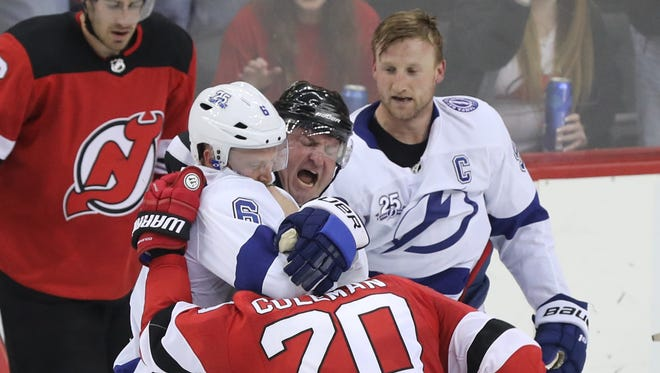 Anton Stralman of Tampa Bay and Blake Coleman of the Devils received two minutes for roughing on this first-period play. The linesman attempts to break up the fight during Game 4 of the Stanley Cup Playoffs first round at Prudential Center in Newark on Wednesday, April 18, 2018.