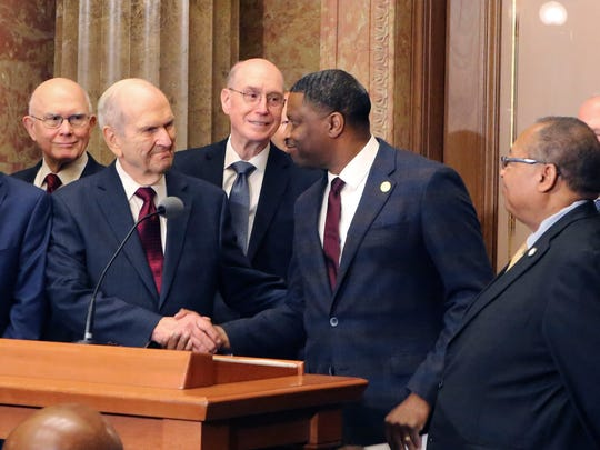FILE - In this May 17, 2018, file photo, Mormon church President Russell M. Nelson shakes hands with Derrick Johnson, president of the NAACP during a news conference, in Salt Lake City. The Mormon church on Friday, June 1, 2018, will celebrate the 40th anniversary of reversing its ban on black people serving in the lay priesthood, going on missions or getting married in temples, rekindling debate about one of the faith's most sensitive topics. (AP Photo/Rick Bowmer, File)