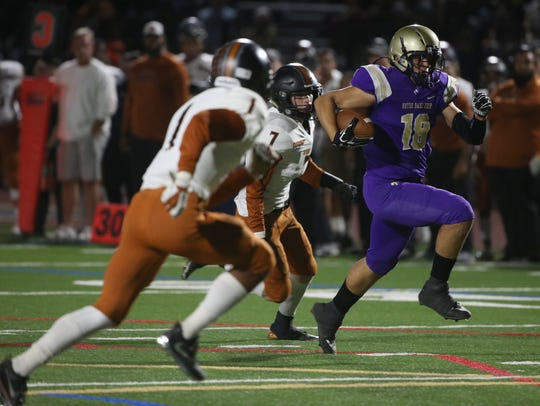 Notre Dame Prep's Harrison Copoloff (18) catches a