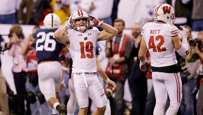 Badgers safety Leo Musso (left) reacts in the fourth quarter against Penn State.