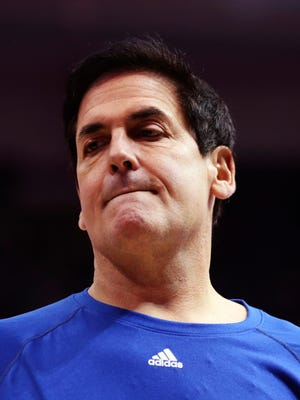 Dallas Mavericks owner Mark Cuban reacts during a game against the Charlotte Hornets at American Airlines Center.