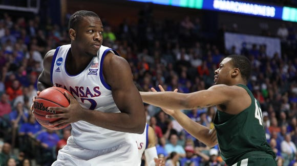 Former KU forward Dwight Coleby (22) brings down a rebound during the second half against the Michigan State Spartans in the second round of the 2017 NCAA Tournament at BOK Center. Mandatory