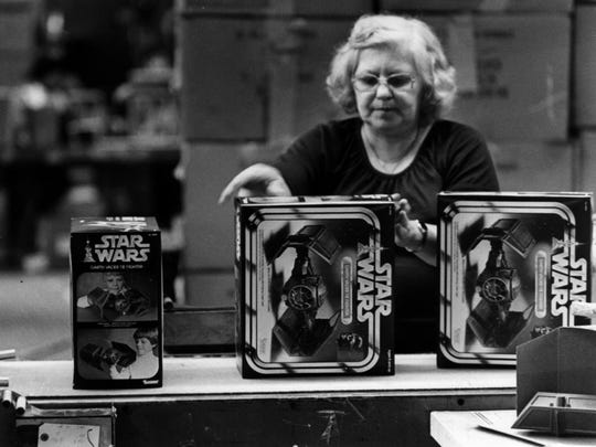 A Kenner employee inspects the packaging of 'Star Wars' toys on the assembly line in 1979.
