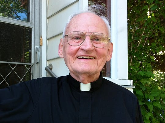 Rev. Alfred Bebel, shown in front of his house in Binghamton, was ordained as a priest in 1958.