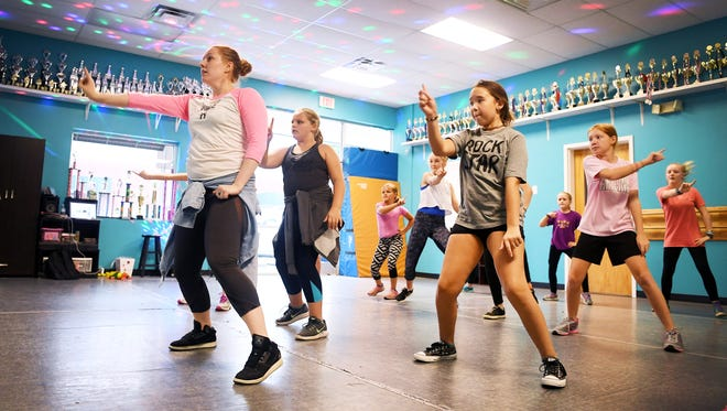 Megan Powell, left, teaches a hip-hop routine to students at Center Stage Dance Studio in South Asheville on Sept. 13, 2017.