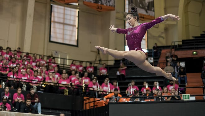 Oregon State freshman Kaitlyn Yanish competes  on beam during the DAM Cancer meet at Gill Coliseum on Feb. 3, 2018.