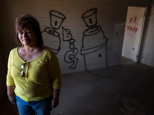 Irene Favila stands in an abandoned unit of the Floydada farm labor housing camp that shut down over a decade ago in Floydada, Texas, on Aug.18, 2015. Under Texas law, facilities intended to house migrant farmworkers must be inspected and licensed, ensuring they meet a minimum standard of cleanliness and safety.