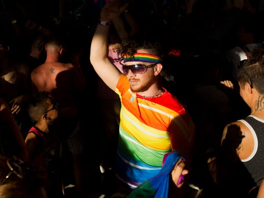 Revelers dance during the 36th annual Phoenix Pride
