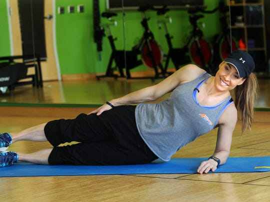 Catherine Andersen, owner and personal trainer of Adventure Boot Camp and Achieve Personal Fitness at Balance Fitness demonstrates the starting position for the side plank with hip dip exercise.