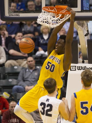 Homestead senior Caleb Swanigan slam-dunks during the Class 4A boys' basketball state finals March 28.