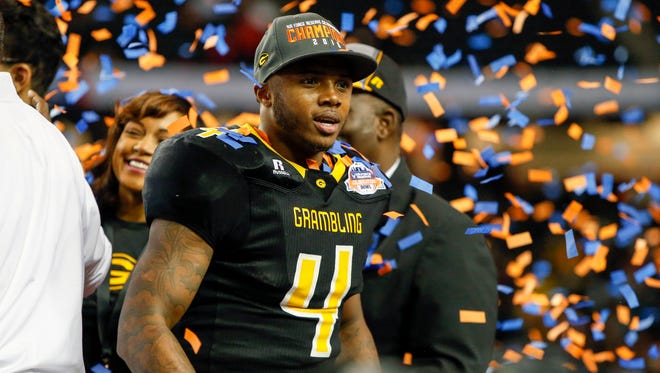 Grambling State running back Martez Carter (4) celebrates a victory against the North Carolina Central Eagles in the Celebration Bowl at the Georgia Dome. Grambling State won 10-9.