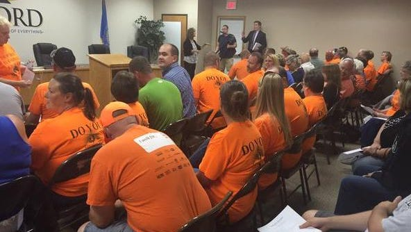 Orange-clad Growing Hartford supporters attended Tuesday's city council meeting.