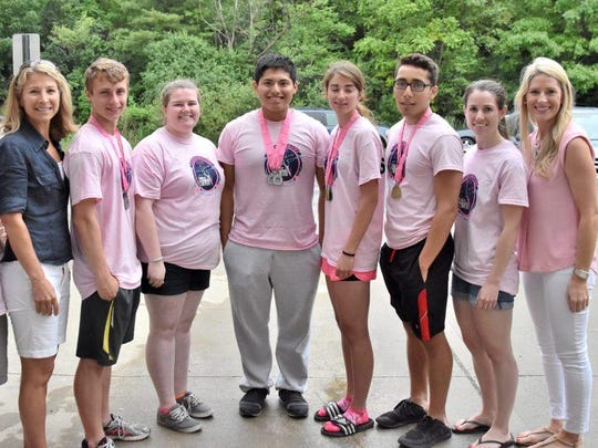 From left, Bill Rooney, Miles of Hope Breast Cancer Foundation Executive Director Pari Forood, Daniel Gisolfi, Rachael Quimby, Raul Aguilar, Rachel Mannino, Issa Dahdal, Nicole Rooney, and Susan G. Komen's Greater NYC Director of Development & Strategic Partnerships Courtney Gush, pose at Sunday's Row for the Cure.