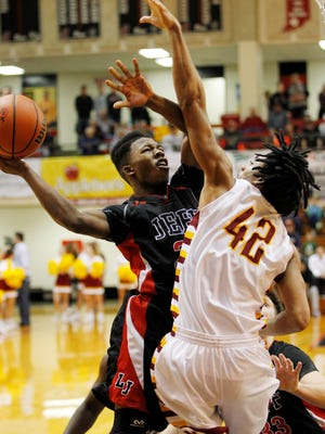 Lafayette Jeff's David Hanyard is fouled by McCutcheon's Billy Loft in the championship of the J&C Hoops Classic Saturday, December 5, 2015, at Lafayette Jeff. Jeff upset McCutcheon 57-56 to win the championship. Hanyard was named tournament MVP.