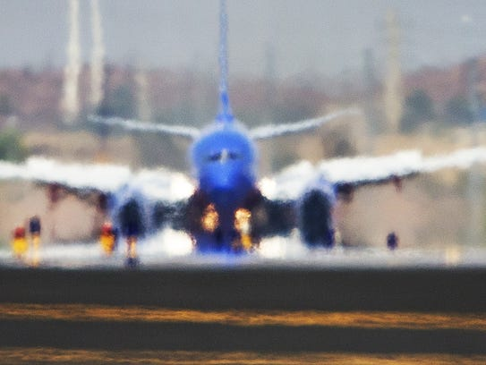 A Southwest Airlines 737 appears as a mirage from heat