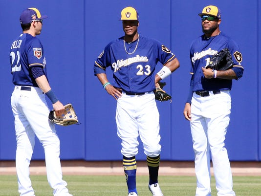 Christian Yelich, Keon Broxton and Santiago Domingo
