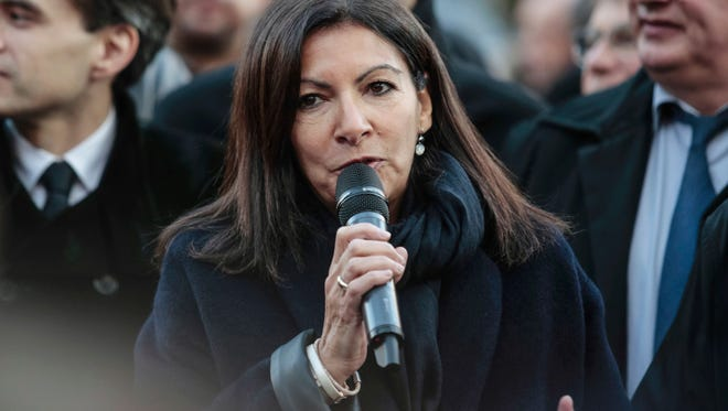 The mayor of Paris, Anne Hidalgo, speaks during the presentation of the new Trilib selective recycling bins and containers in Paris on Dec. 5, 2016.