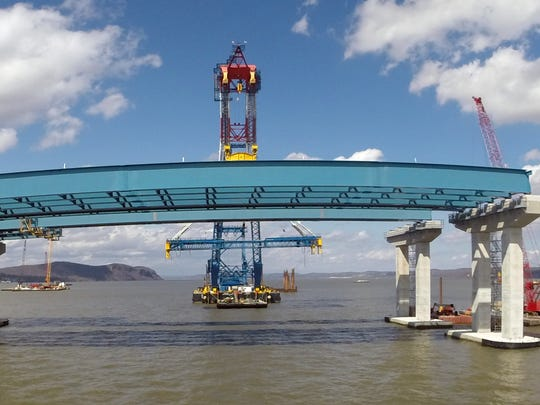 The Left Coast Lifter super crane works to install girder assemblies during construction of the new Tappan Zee Bridge April 1, 2016.