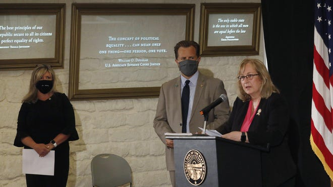Rep. Laura Lanese of Grove City speaks at a Statehouse news conference Thursday about the introduction of legislation that would repeal House Bill 6. With her were two fellow Republicans, Rep. Rick Carfagna of Genoa Township and Sen. Stephanie Kunze of Hilliard.