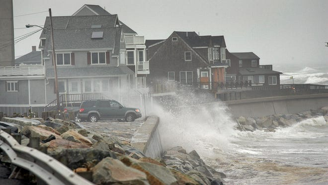 Waves come over the sea wall on Ocean Street in Marshfield on Monday, Oct. 29, 2012.