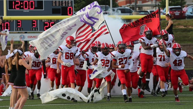 South Point takes the field ahead of a football game against rival Stuart Cramer in 2018.