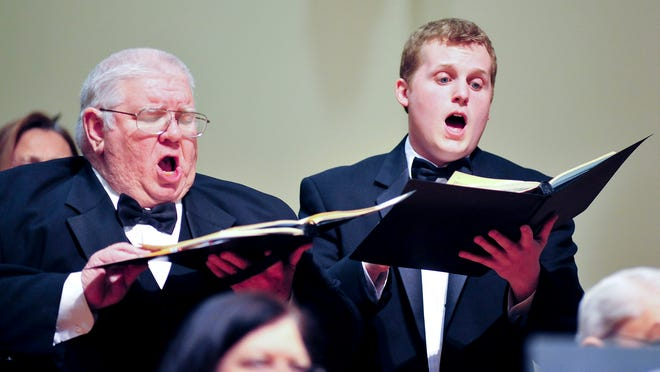 Tenors Charlie Davis, left, and Kevin Gilman sing in a 2011 performance of the Louisville Chorus.