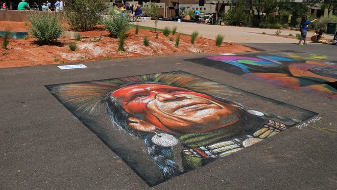 Anat Ronen's contribution to the Kayenta Street Painting Festival can be seen with the new Kayenta Center for the Arts in the background. The center will be dedicated Friday.