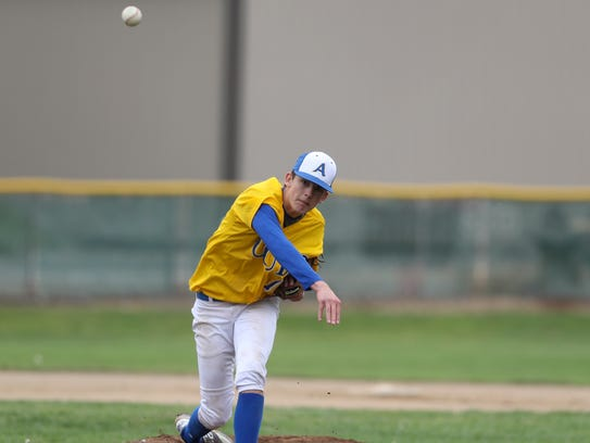 Anderson High School pitcher Carson Shaw delivers the