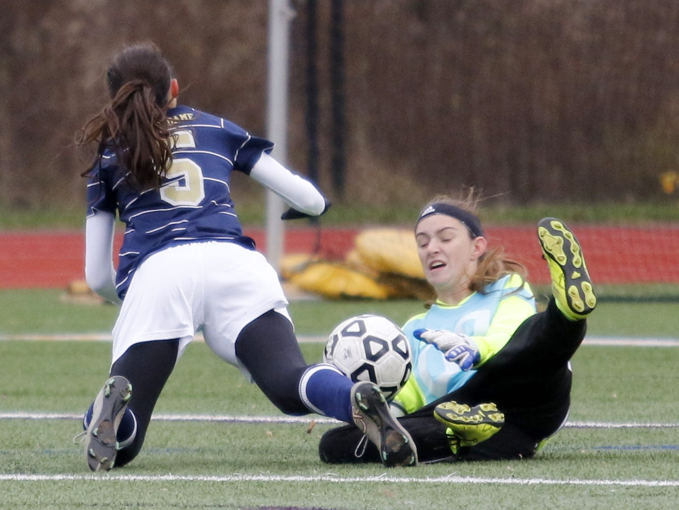 Schohaire goalie Desiree Palmatier makes a sliding save on a shot by Notre Dame's Laurel Vargas in the first half of Saturday's Class C state semifinal at Cortland High School.